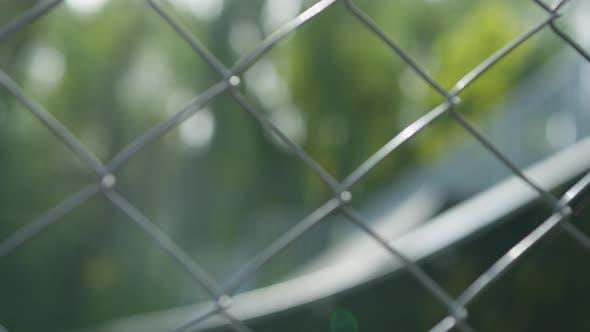 Skater seen through a fence