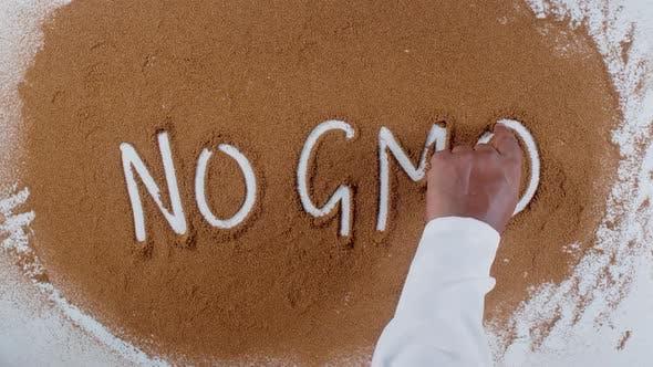 Thumbnail for Hand Writes On Soil No Gmo