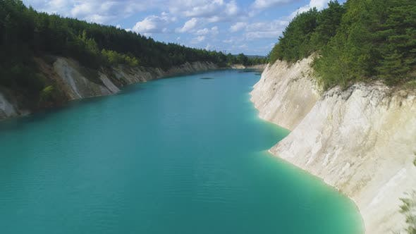 Cover Image for Aerial Video. Slow Flight with a Smooth Rise Up Over a Large Abandoned Gypsum Quarry.