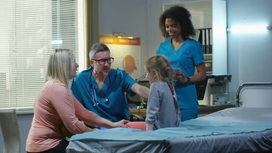 Thumbnail for Doctor Examining Girls Abdomen