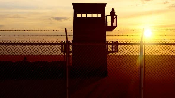 Thumbnail for Soldier Standing Guard in Military Watchtower and Sunset View
