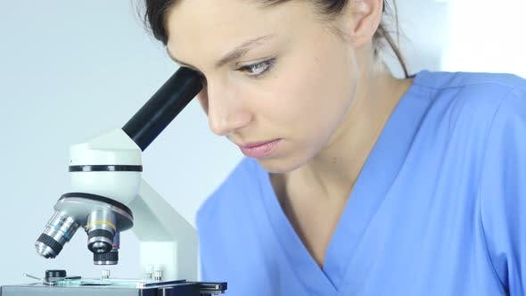 Thumbnail for Scientist using Microscope in Laboratory for Research