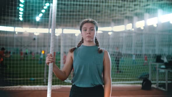 Thumbnail for Pole Vaulting - Young Woman Is Standing with a Pole in Hands