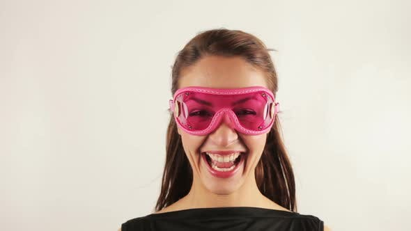 Thumbnail for Woman wearing retro goggles making faces