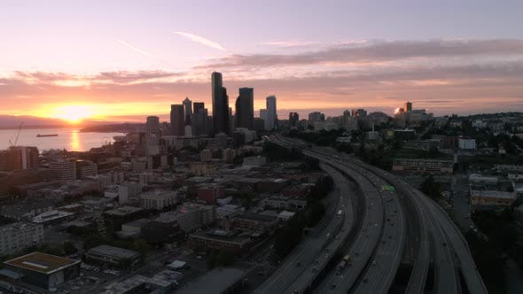Cover Image for Helicopter Aerial Of Seattle City Skyline With Red Lens Flare From Glowing Sunset