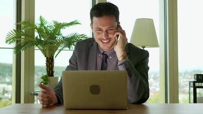 Sales Person Working on Laptop Computer Desk