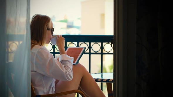 Thumbnail for Young Woman With Touchpad on Hotel Balcony