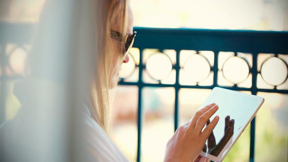 Cover Image for Woman With Tablet Pc