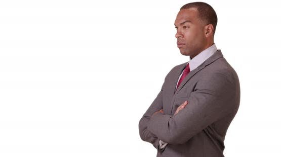 A black businessman looking confident on a white background