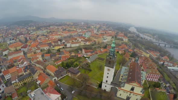 Thumbnail for Aerial Panorama of Old City Downtown, City Hall Tower, Mountains on Horizon