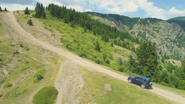 Blue Jeep Climbing Rocky Hills in Sopot Bulgaria