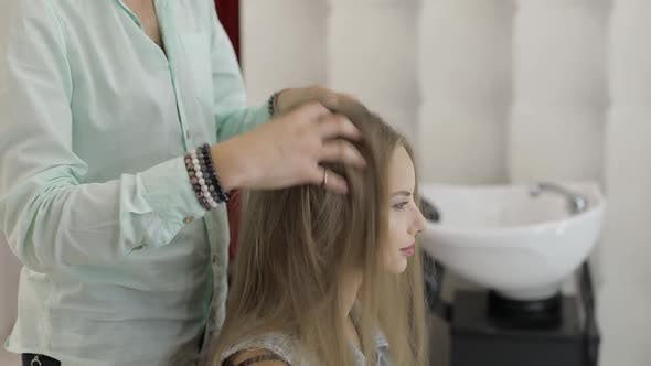 Professional Hairdresser Styling Fixes Model Hair. Making Volume Hairstyle