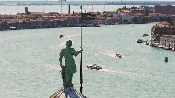 Thumbnail for Wide Waterspace with Speedboats Between Rows of Buildings, Male Statue at Front