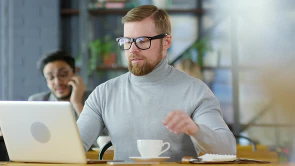 Thumbnail for Redhead Businessman Having Coffee and Working on Laptop in Cafe