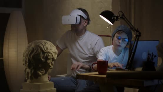 Thumbnail for Father and Son Using VR Technology