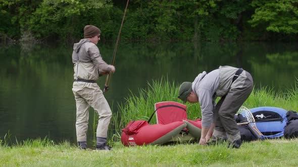 Thumbnail for Fly fishermen prepare for fishing