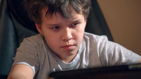 Thumbnail for Kid With Tablet Pc At Table