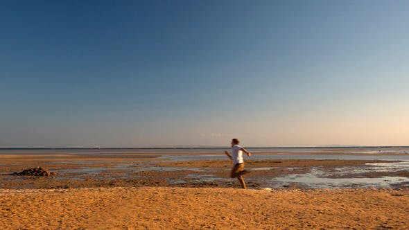 Thumbnail for Excited Man Running on Beach