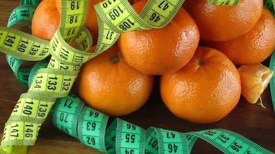 Mandarin And Tape Measure Turning