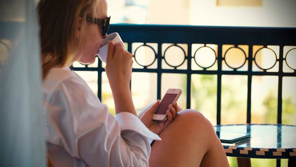 Thumbnail for Woman Typing Sms And Having Tea