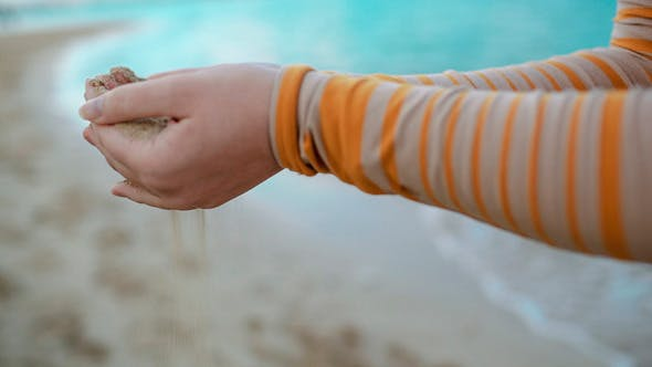 Thumbnail for Sand Pouring Out Of Female Hands
