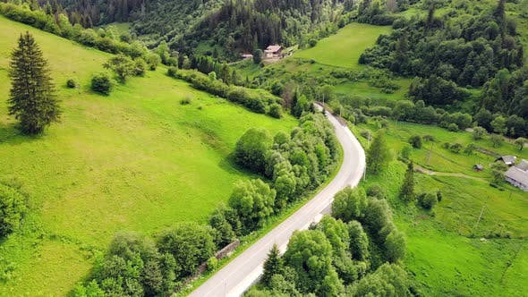 Aerial View Road in the Mountains Among the Picturesque Landscape of Green Mountains, The Mountain