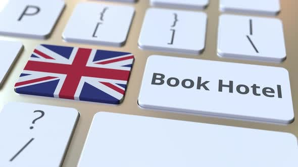 BOOK HOTEL Text and Flag of Great Britain on the Keyboard
