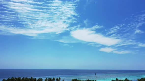 Beautiful fly over tourism shot of a sunshine white sandy paradise beach and turquoise sea backgroun