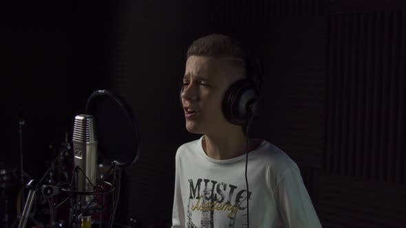 Thumbnail for Boy Singing Into Studio Microphone