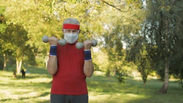 Thumbnail for Senior Man Making Fitness Exercises with Dumbbells During Coronavirus Virus Pandemic Alone in Park