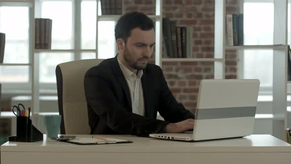 Thumbnail for Young Stressed Businessman Working on Computer Laptop Late at Night in Suit and Tie Isolated on