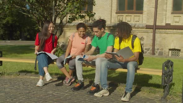 Diverse Students with Textbooks Learning at Campus