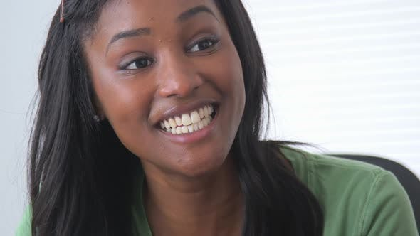 Thumbnail for Happy Black businesswoman in meeting