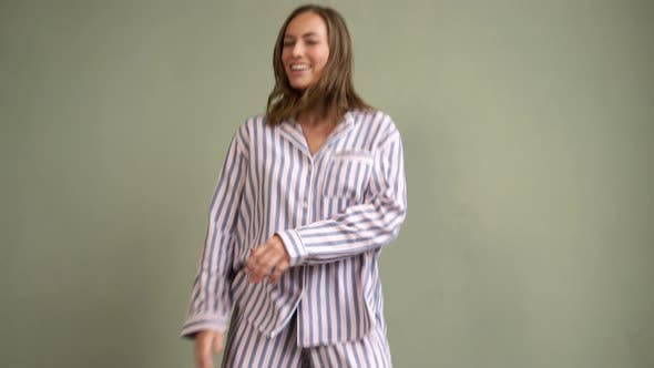 Thumbnail for Sexy Lady in Pajamas Jumping on Sofa