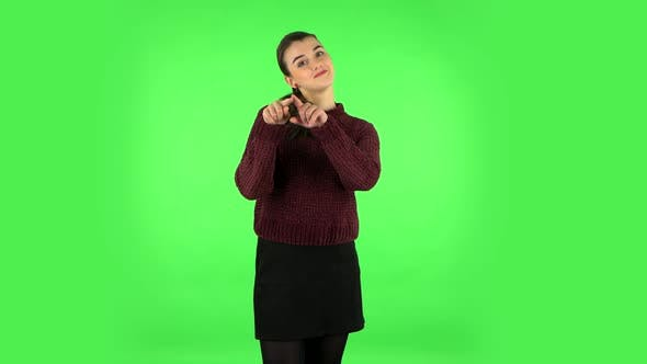 Thumbnail for Cute Girl Smiles and Showing Heart with Fingers Then Blowing Kiss. Green Screen