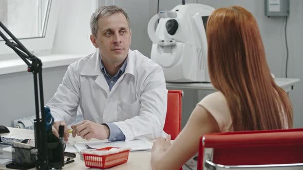 Thumbnail for Eye Doctor Giving Advice to Female Patient