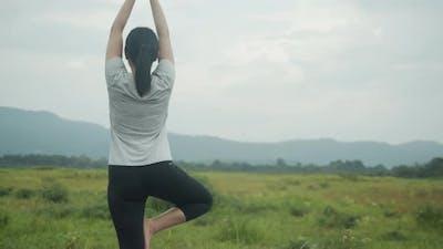 Young Asian woman doing yoga exercise meditation performing a spiritual yoga.