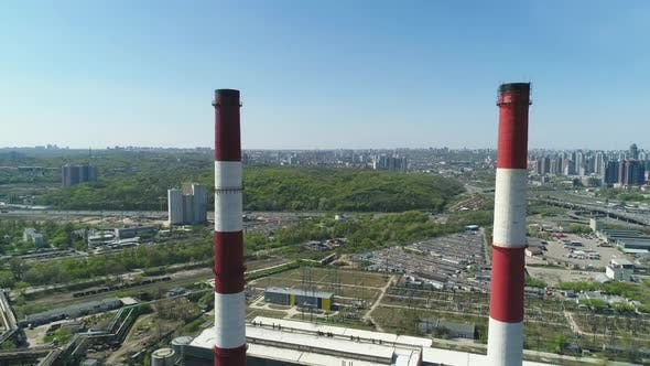 Thumbnail for Aerial Drone View of Large Red and White Chimney Without Smoke at Sunny Day