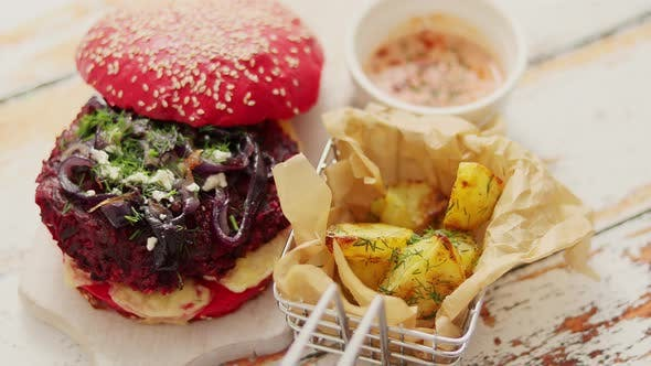 Thumbnail for Homemade Vegetable Beetroot Burgers. Red Colored Sesame Bun. Served with Goat Cheese, Feta