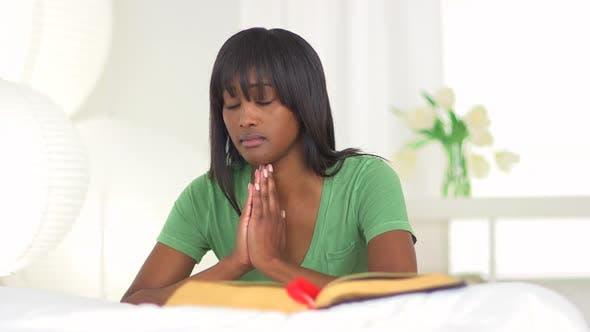 Thumbnail for Black woman praying
