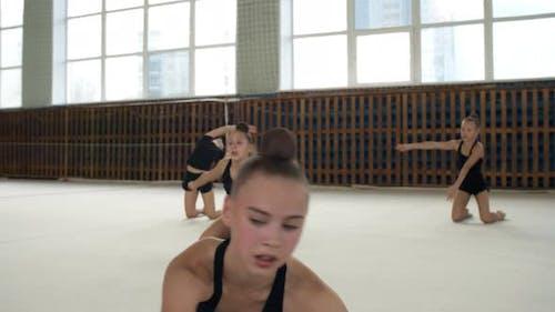 Teenage Girl Practicing Rhythmic Gymnastics