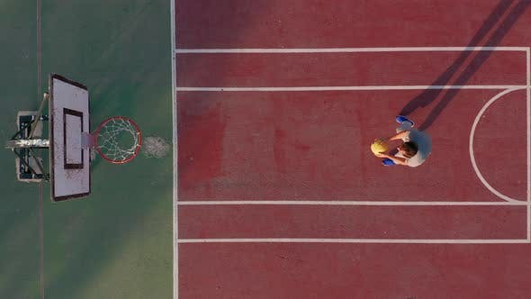 Thumbnail for Aerial View. Man Playing Basketball on the Court.