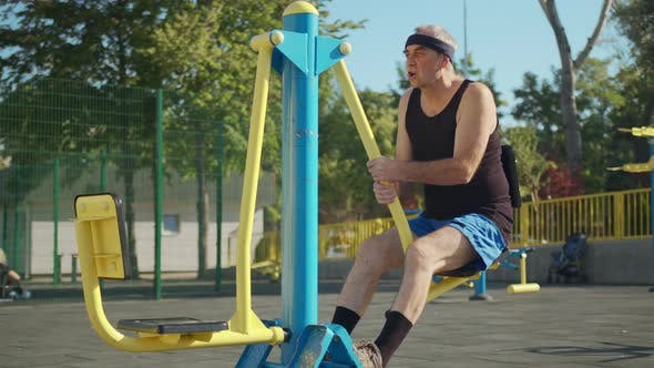 Thumbnail for A Retired Elderly Man Works Out on a Sports Ground Outside. Healthy Lifestyle Concept