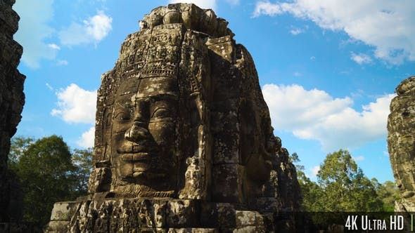 4K Ancient Stone Faces of Bayon Temple inside of Angkor Thom in Siem Reap, Cambodia