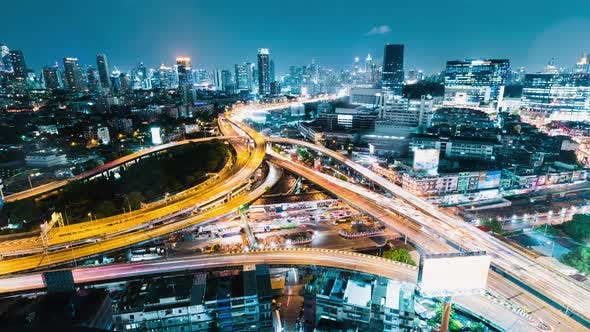 Thumbnail for Time-lapse of car traffic transportation on highway road intersection in Bangkok city at night