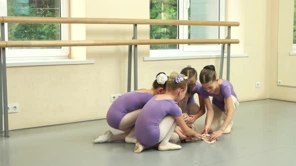 Group of Beautiful Little Ballerinas During Break
