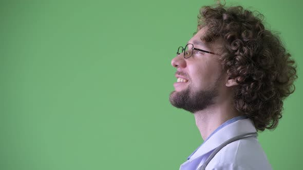 Thumbnail for Closeup Profile View of Happy Young Bearded Man Doctor Thinking