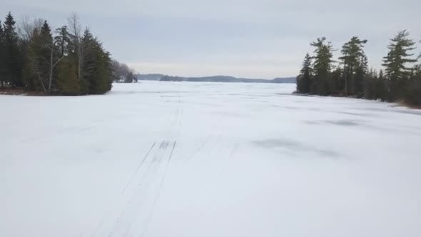 Thumbnail for Aerial Drone View Flying Above Frozen Ice Lake In Winter 2