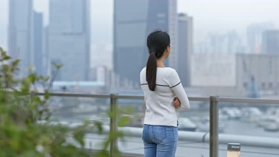 Thumbnail for Woman look at the city in Hong Kong