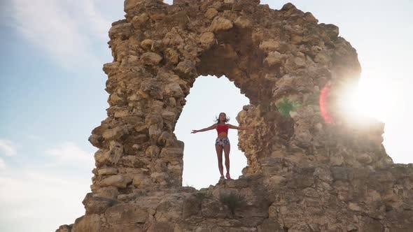 The Girl Is a Traveler Walks in the Ruins of an Ancient Kalamita Fortress in the Crimea Sebastopol.